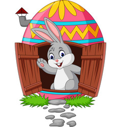 Cartoon bunny with decorated easter eggs house vector
