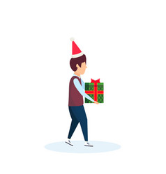 boy wearing hat holding gift box happy new year vector image