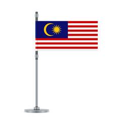 Malaysian flag on the metallic pole vector