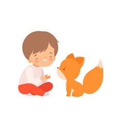 Smiling boy playing with fox cub kid interacting vector