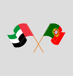 Crossed and waving flags portugal vector