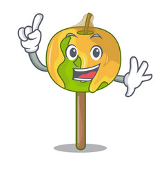 Finger candy apple mascot cartoon vector