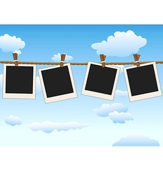 hanging Blank photo frames on blue sky vector image vector image