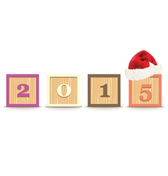 2015 made from toy blocks with christmas hat vector
