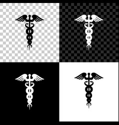 caduceus medical symbol icon isolated on black vector image