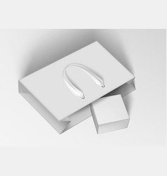 white paper shopping bag with gift box vector image