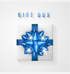 white gift box with blue bow and ribbon top view vector image