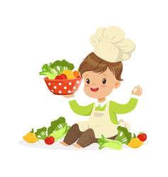 Cute little boy chef cooking fresh vegetables vector