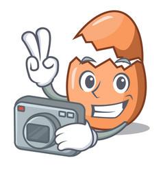 Photographer shell of broken egg on the mascot vector