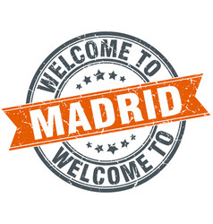 Welcome to madrid orange round ribbon stamp vector