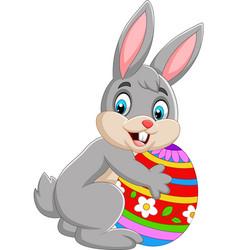 cartoon bunny holding easter egg vector image