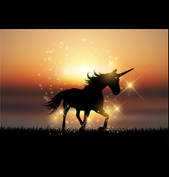 Silhouette of a unicorn in a sunset landscape vector
