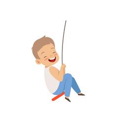 Happy boy swinging on a rope swing little kid vector