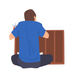 man assembling and installing new furniture home vector image
