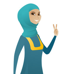 Young muslim businesswoman showing victory gesture vector