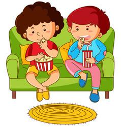 Two boys eating popcorn on sofa vector