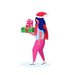 woman wearing hat holding gift box happy new year vector image