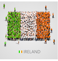 Large group of people in the ireland flag shape vector