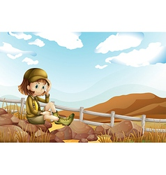 A female explorer sitting above the rock near the vector image