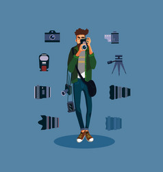 young male photographer with many photo equipment vector image