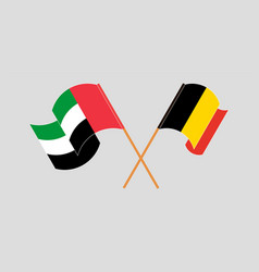 Crossed and waving flags belgium and united vector