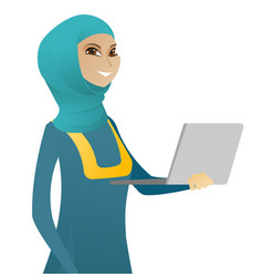 Young muslim business woman using a laptop vector