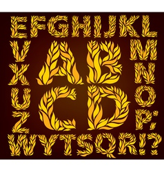 Alphabet yellow leaves vector image vector image