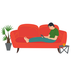 A man lying on sofa holding a smartphone vector