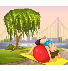 A girl keeping her body fit near the tree vector image