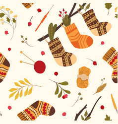 Knitted woolen socks flat seamless pattern warm vector