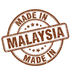 made in malaysia brown grunge round stamp vector image