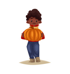 Cartoon black boy holding pumpkin vector