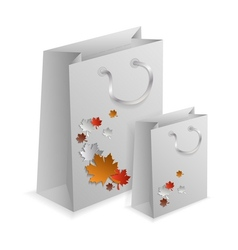 Couple of embellished paper shopping bags vector