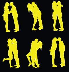 couple kissing yellow silhouette vector image