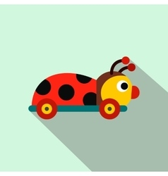 Colored ladybug toy on a wheels flat icon vector