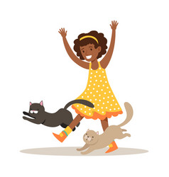 Happy little girl playing with two kittens vector