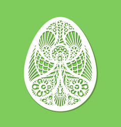 Lacy easter egg art on green background vector