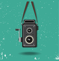 Hanging old camera vector