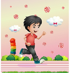 A boy running outside with candy balls vector