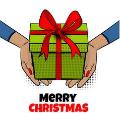 pop art woman hand hold gift box ribbon vector image