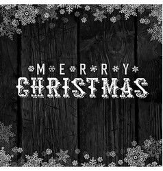 Wooden black christmas background with snowflakes vector