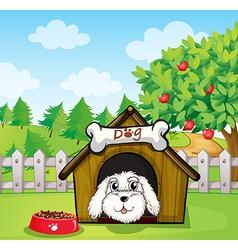 A puppy inside a doghouse near an apple tree vector image