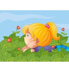 A little girl hiding in the garden vector image