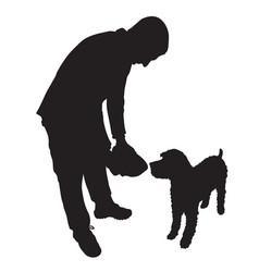 man feeding dog vector image vector image