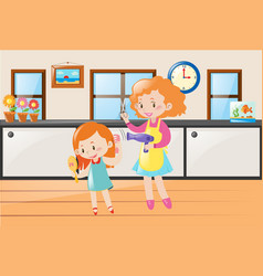 Mother helping little girl drying hair vector