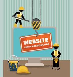 website under construction with desktop computer vector image