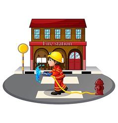 A fireman holding a hose vector image vector image