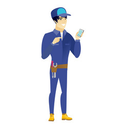 Asian mechanic holding a mobile phone vector