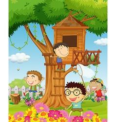 Boys playing in the garden vector