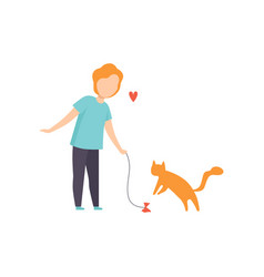 boy playing with his red cat adorable pet and its vector image